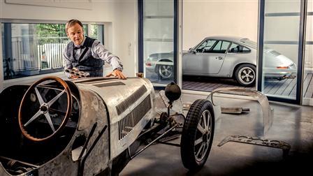 Porsche Achim Anscheidt in front of its Bugatti Type 20